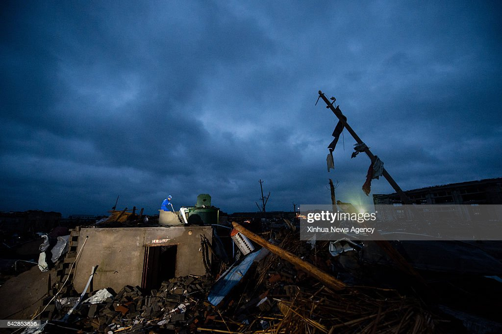 Rescuers search for the survivors in Beichen Village of Funing County, Yancheng City, east China's Jiangsu Province, June 24, 2016. At least 78 people died and 500 were injured in one of the deadliest natural disasters to hit Jiangsu in decades Thursday. Downpours, hailstorms and the worst tornado since 1966 battered parts of Yancheng City at 2:30 p.m. Thursday, destroying homes and trapping hundreds of villagers in the rubble.