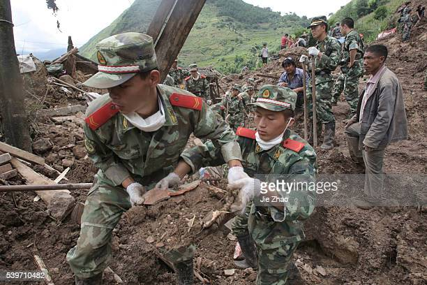 Rescuers search for victims during a mudslide at Wama Village of Baoshan Yunnan Province September 3 2010 Chinese rescuers on Friday searched a...