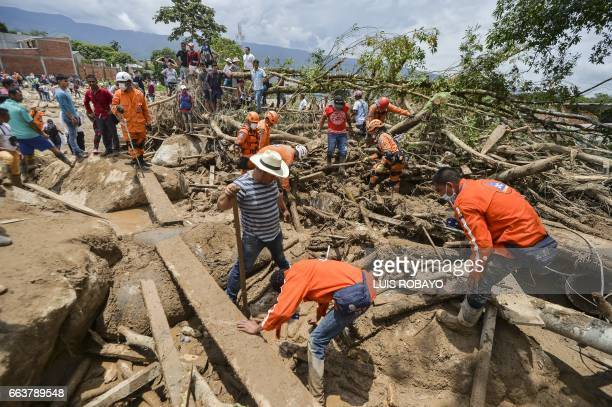 Rescuers search for victims following mudslides caused by heavy rains in Mocoa Putumayo department southern Colombia on April 2 2017 The death toll...
