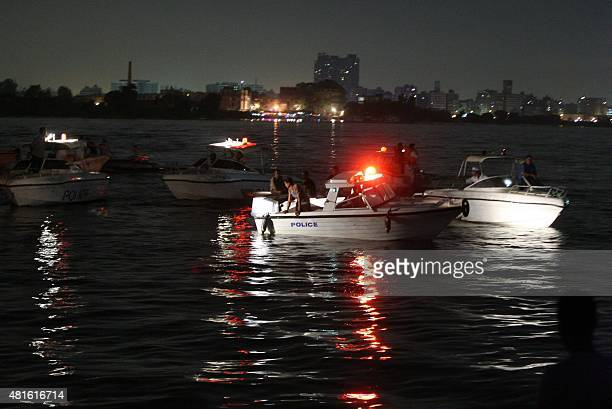 Rescuers search for victims in Cairo Egypt on July 23 2015 where at least 21 people including two children were killed after a cargo boat collided...