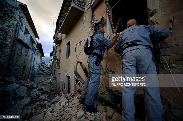 TOPSHOT Rescuers search for victims in the rubble after a strong earthquake hit Amatrice on August 24 2016 Central Italy was struck by a powerful...