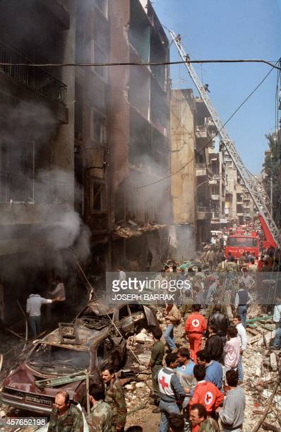 Rescuers secure 25 March 1986 a street after a car bomb explosion in the Ashrafieh district of mainly Christian East Beirut The car packed with 150...