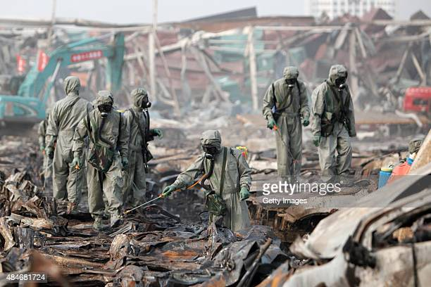 Rescuers spray hydrogen peroxide at the site of Tianjin warehouse explosion on August 20 2015 in Tianjin China The death toll from last week's...