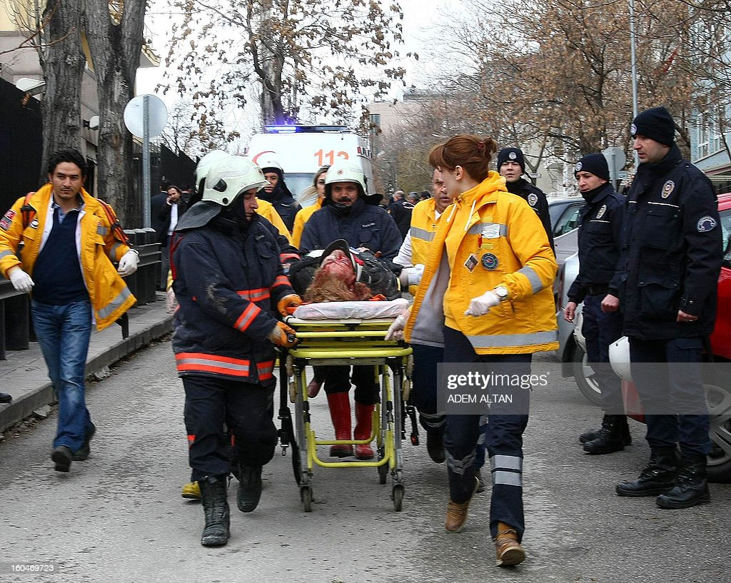 Rescuers take on February 1, 2013 a victim of a blast outside the US Embassy in Ankara to a waiting ambulance. Two security guards were killed in the blast outside the US embassy, local television reported, amid speculation it was a suicide attack. The force of the explosion damaged nearby buildings in the Cankaya neighborhood where many other state institutions and embassies are also located.