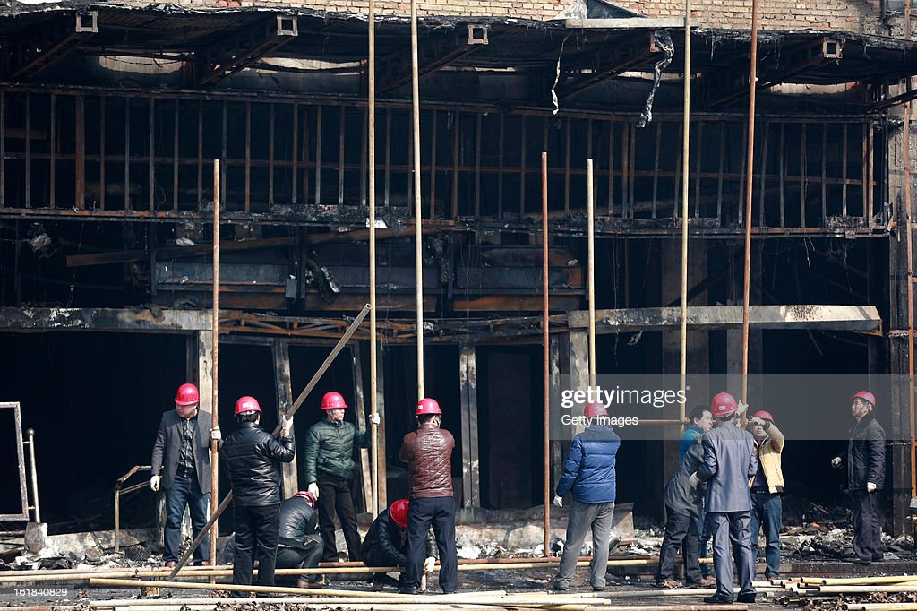 Rescuers work at a fire site at a supermarket on February 17, 2013 in Changzhi, China. The supermarket caught fire at 4:10 a.m. today and was put out two hours later without any reports of casualties.