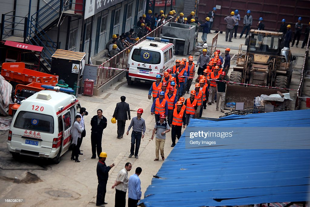 Rescuers work at a subway construction site after a cave-in at Tonghuamen and Hujiamiao stations on May 6, 2013 in Xi'an, Shaanxi Province of China. One person was injured and five others remain buried after part of a subway line that is under construction caved in on early Monday.