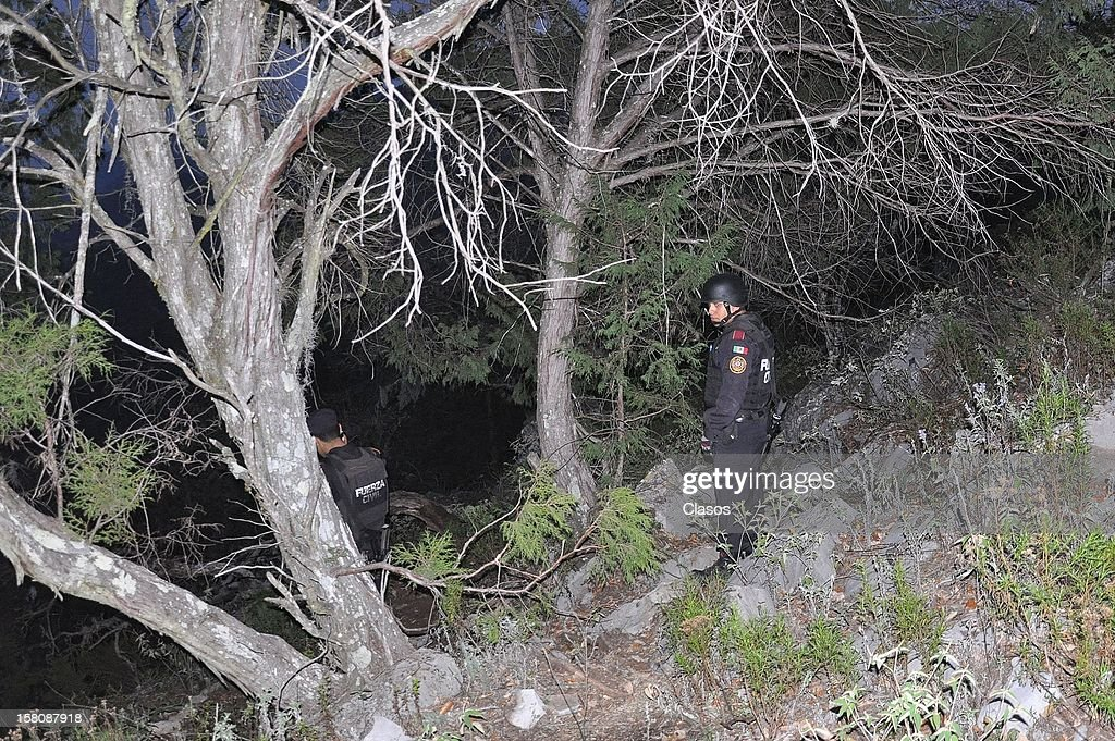 Rescuers work at the area where the plane where the mexican singer Jenni Rivera was flying crashed, close to the Tejocote Ranch, on December 09, 2012 in Monterrey, Mexico. The plane where the 43-year-old singer and her band were travelling crashed on their way to the city of Toluca.