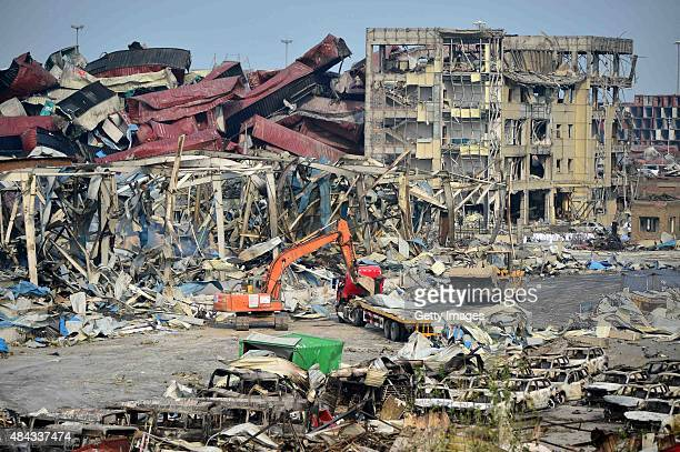 Rescuers work at the blast site during the aftermath of the warehouse explosion on August 17 2015 in Tianjin China The death toll has risen to 114...