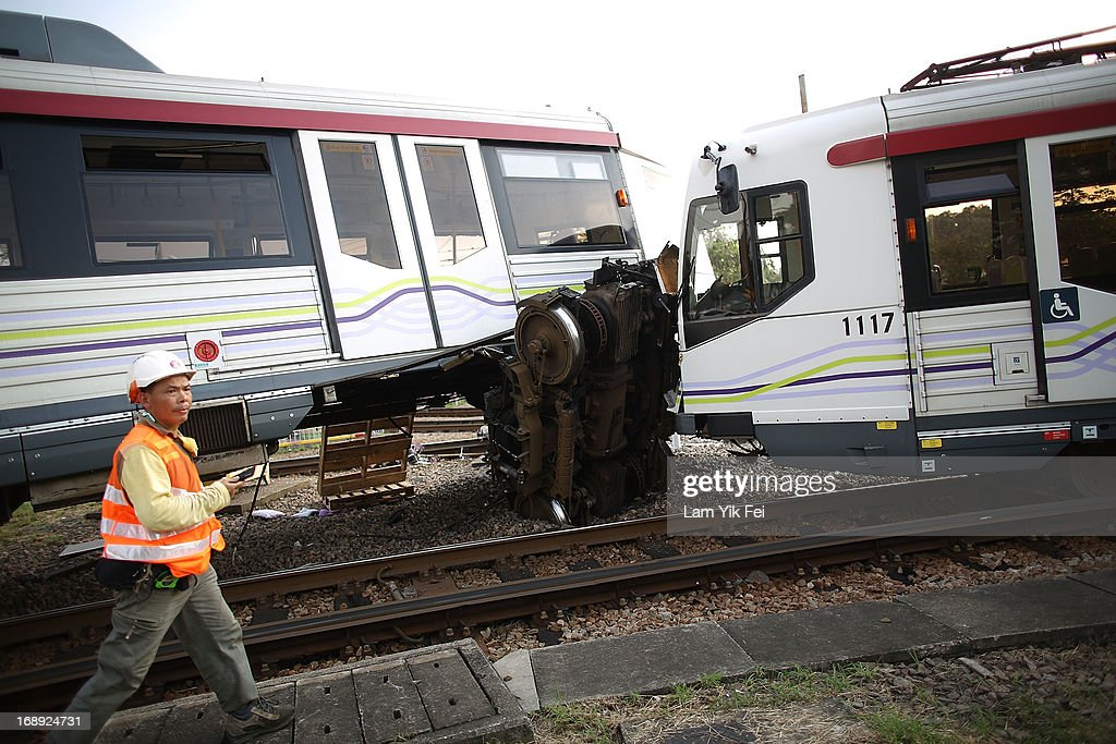 Rescuers work at the scene after the crash of two light railway trains on 17 May, 2013, near Hang Mei Tsuen Station at Tin Shui Wai in Hong Kong. Over 62 people are hurt in the accident, in which three victims are seriously injured. on May 17, 2013 in Hong Kong, Hong Kong.