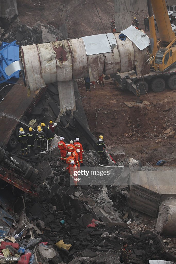 Rescuers work at the scene of the collapsed Yichang bridge near the city of Sanmenxia, central China's Henan province, on February 1, 2013 after a fireworks-laden truck exploded as it crossed the bridge killing 26 people as the structure collapsed and vehicles plummeted to the ground, state-run media reported. An 80-metre long part of the bridge collapsed and six vehicles had been retrieved from the debris, China's official news agency Xinhua said. The bridge near the city of Sanmenxia is on the G30 expressway, the longest road in China, which stretches for nearly 4,400 kilometres (2,700 miles) from China's western border with Kazakhstan to the eastern Yellow Sea.