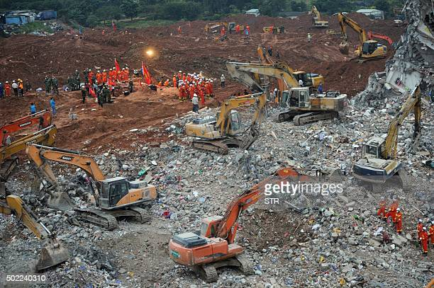 Rescuers work at the site of a landslide that hit an industrial park in Shenzhen south China's Guangdong province on December 22 2015 Rescuers...