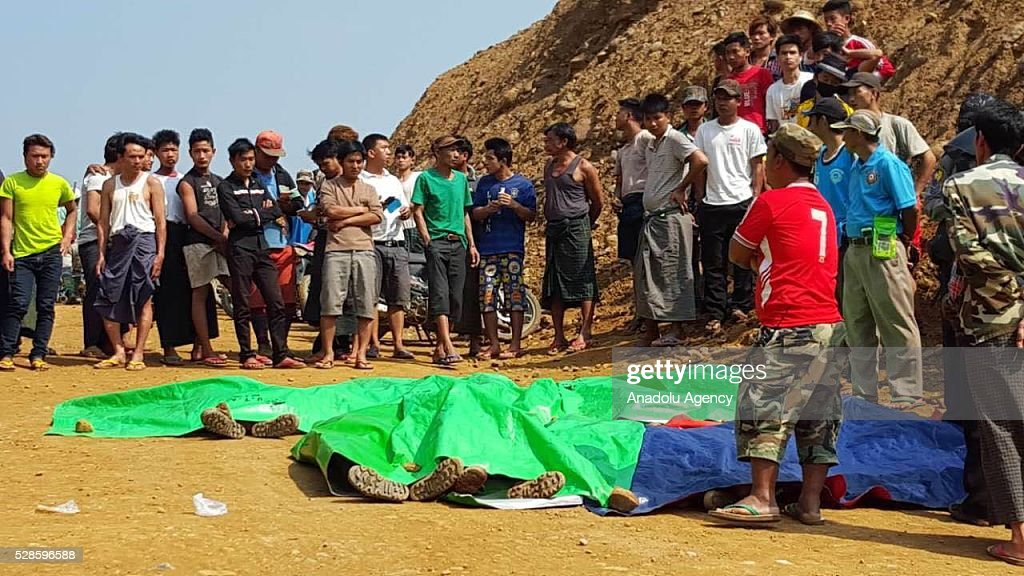 Rescuers work at the site of landslide in Hpakant Township in northern Kachin, Myanmar on May 06, 2016. At least 14 people have been confirmed dead and dozens are feared missing after a landslide at a jade mine in Myanmars restive Kachin State.