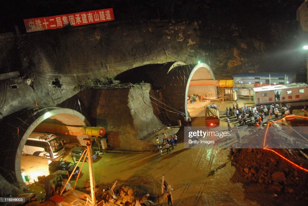 Rescuers work at the tunnel collapse site on July 18 2011 in Dalian Liaoning Province of China A tunnel which is being constructed collapsed on...
