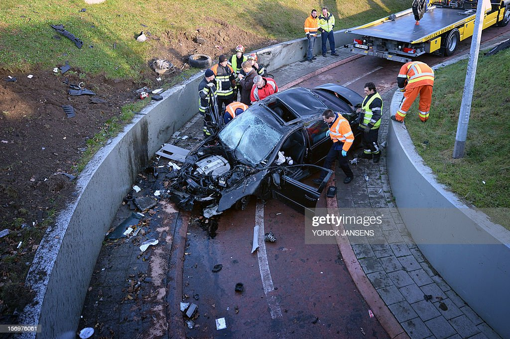 Rescuers work on a crashed car at the Rode Kruislaan in Bree, on November25, 2012. One person died in the accident, two were seriously injured. AFP PHOTO YORICK JANSENS
