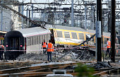 Rescuers work on the site of a train accident in the railway station of BretignysurOrge on July 12 2013 near Paris At least seven people were dead...