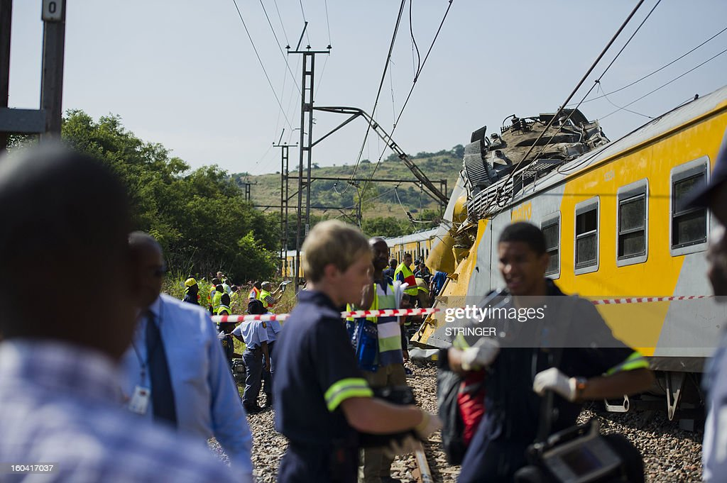 Rescuers work on the site of a train accident near Kalefong station, Attridgeville, in the west of Pretoria on January 31, 2013. The collision between two passenger trains packed with school kids and rush-hour commuters in Pretoria that injured up to 300 people has being blamed on cable theft, the authorities said. The crash took place at around 7.10am (0510 GMT) when a commuter train heading from the suburbs to the capital ploughed into a stationary train on the same track.