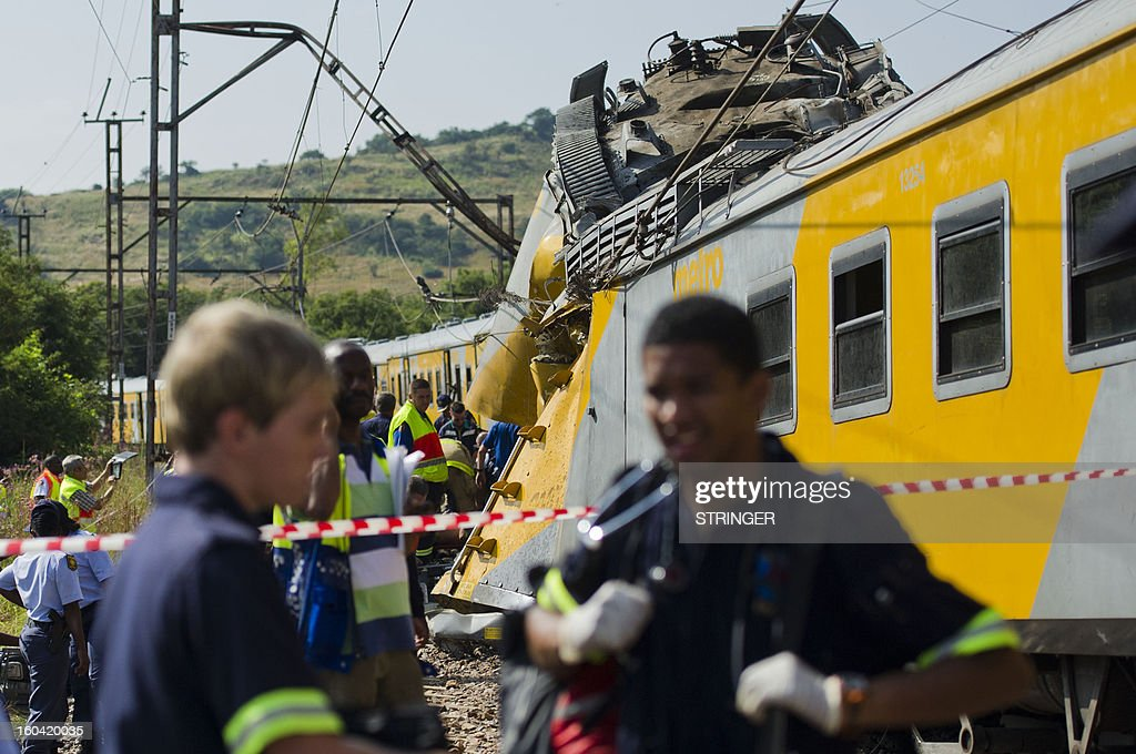 Rescuers work on the site of a train accident near Kalefong station, Attridgeville, in the west of Pretoria on January 31, 2013. The collision between two passenger trains packed with school kids and rush-hour commuters in Pretoria that injured up to 300 people has being blamed on cable theft, the authorities said. The crash took place at around 7.10am (0510 GMT) when a commuter train heading from the suburbs to the capital ploughed into a stationary train on the same track. AFP PHOTO / STRINGER