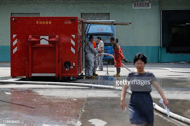 Rescuers work outside a cold storage unit following an ammonia leak in Baoshan district of Shanghai on August 31 2013 An ammonia leak from a cold...