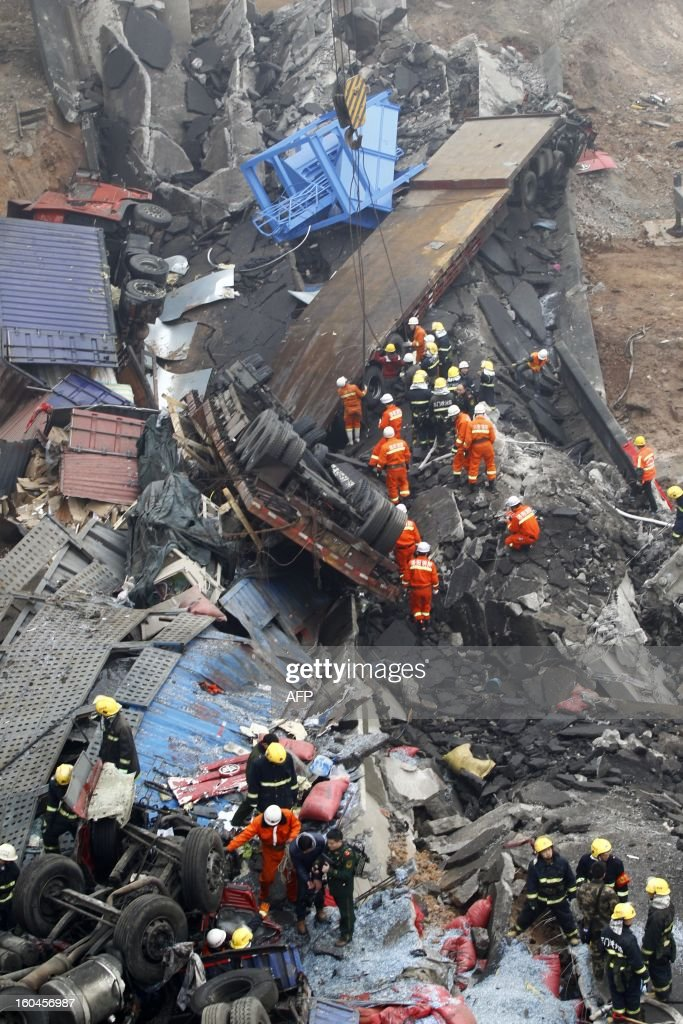 Rescuers work under the collapsed Yichang bridge near the city of Sanmenxia, central China's Henan province, on February 1, 2013. A fireworks-laden truck exploded as it crossed a bridge in central China on Friday, killing 26 people as the structure collapsed and vehicles plummeted to the ground, state-run media reported. An 80-metre long part of the bridge collapsed and six vehicles had been retrieved from the debris, China's official news agency Xinhua said. The bridge near the city of Sanmenxia is on the G30 expressway, the longest road in China, which stretches for nearly 4,400 kilometres (2,700 miles) from China's western border with Kazakhstan to the eastern Yellow Sea.