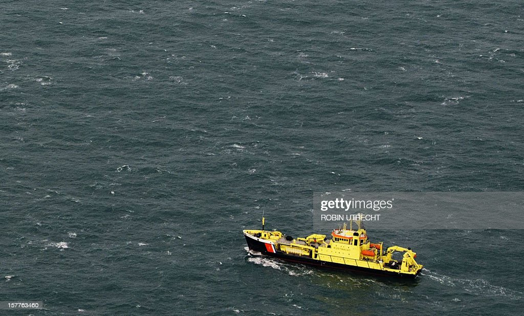 A rescue-vessel takes part in a search and rescue operation for crewmembers of the sunken cargo-vessel the Baltic Ace out from the sea during a rescue operation on December 6 in the North Sea. Dutch sea rescue services launched a major rescue operation for 11 missing sailors after two ships collided in a busy North Sea shipping lane off the coast of Rotterdam with one ship sinking. Rescuers, including the Dutch navy, on December 5, plucked 13 survivors from the water after the Baltic Ace car carrier collided with the Corvus J container ship about 100 kilometres (60 miles) southwest of Rotterdam. A Belgian sea rescue helicopter found another body this morning, the coastguard said, bringing the confirmed death toll to five. Late on December 6 Dutch coastguards called off a search for six crew still missing after their cargo ship sank in the North Sea, saying there was 'zero' chance of finding survivors in the icy waters.