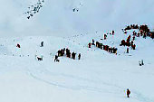 Rescuing teams gather for search and rescue operations on a piste at the avalanche site after skiers including a group on a school outing were swept...
