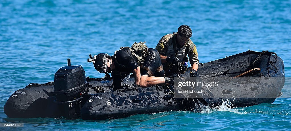 Rescure crewman that where deployed from a U.S military HH-60 Pave Hawk Helicopter are seen entering a rescue boat during Exercise Angel Reign on July 1, 2016 in Townsville, Australia. Exercise Angel Reign is the largest Air Force led field exercise in Australia this year and is a bilateral Joint Personnel Recovery exercise which aims to practice search and rescue activities both at sea and on land.