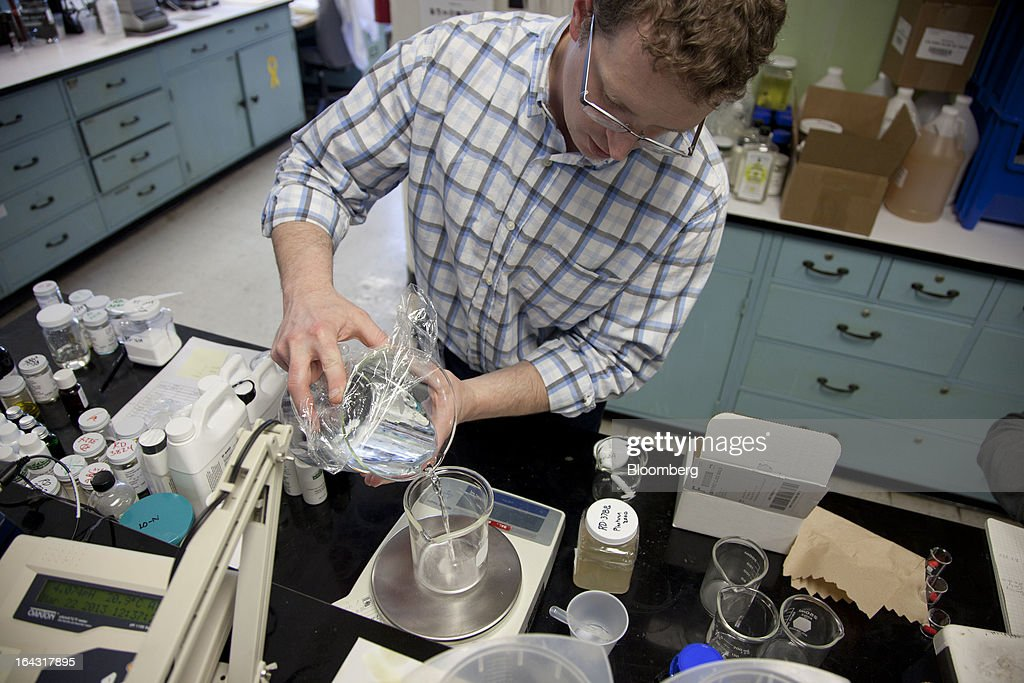 Research and development chemist John Pantzer checks the compatibility of a natural lemon fragrance to be used in window cleaner at the J.R. Watkins production facility in Winona, Minnesota, U.S., on Thursday, March 21, 2013. Watkins Inc., founded in 1868, is a manufacturer of health remedies, baking products, and other household items. Photographer: Ariana Lindquist/Bloomberg via Getty Images