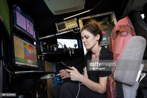Research meteorologist Karen Kosiba monitors a supercell thunderstorm in the Doppler on Wheels vehicle during a tornado research mission May 9 2017...