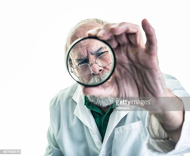 Research Scientist Examining Glass Lens