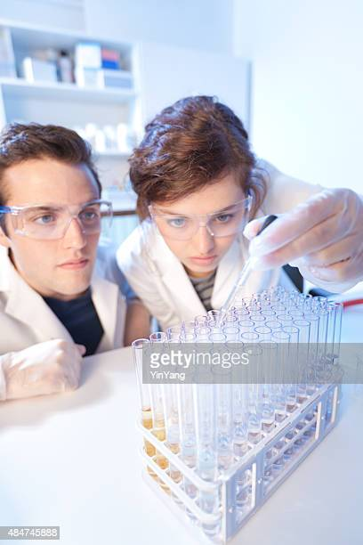 Research Scientists Team Working Together in Laboratory Experiment