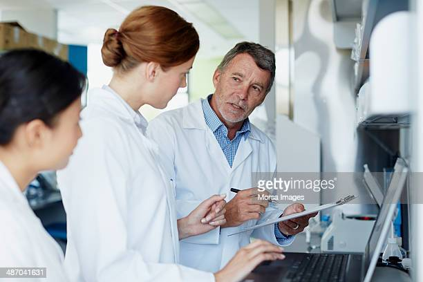 Research team discussing results