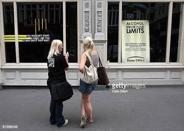 A researcher asks a passerby what she thinks of an unlit window display which shows mannequins posed as a drunken teenagers in various scenarious...