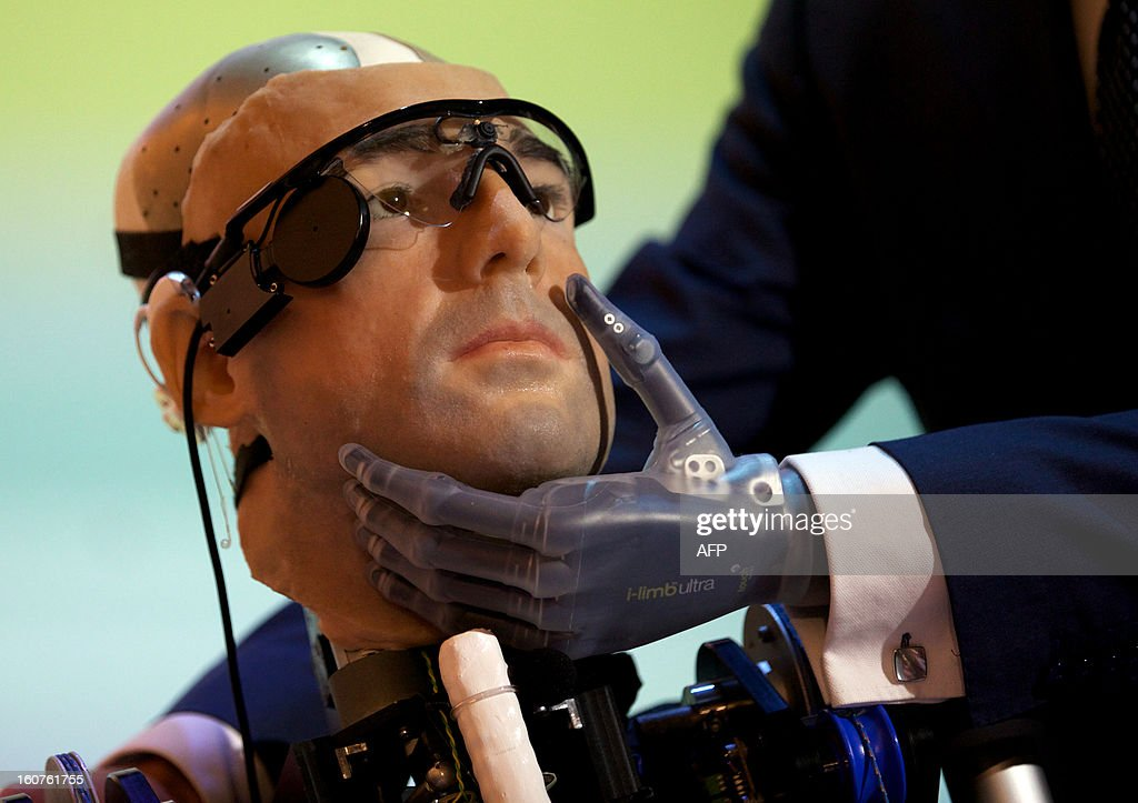Researcher Bertolt Meyer, a lifelong user of prosthetic technology and the model for 'Rex', the world's first 'bionic man', poses with the humanoid during a photo call at the Science Museum in London on February 5, 2013. The 640,000 GBP (1 million US dollars) bionic has a distinctly human shape and boasts prosthetic limbs, a functional artificial blood circulatory system complete with artificial blood, as well as an artificial pancreas, kidney, spleen and trachea. Rex will be displayed at the Science Museum from February 7.