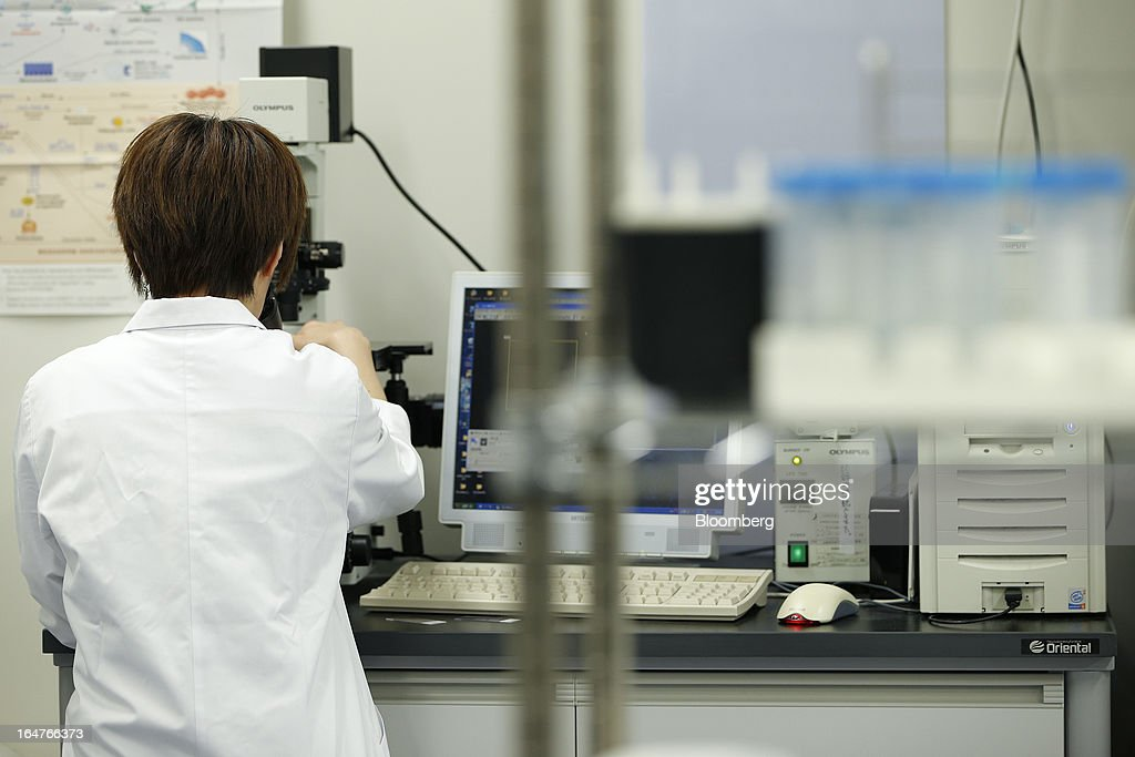 A researcher conducts cellular analyses in a laboratory at Yokohama City University's (YCU) Advanced Medical Research Center (AMRC) in Yokohama City, Kanagawa Prefecture, Japan, on Monday, March 18, 2013. Japan aims to be a nation with the most advanced medical technologies and healthcare services in the world and to develop the medical industries for the revitalization of the country's economy. Photographer: Kiyoshi Ota/Bloomberg via Getty Images