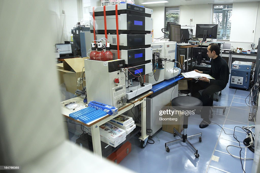 A researcher conducts proteome analyses in a laboratory at Yokohama City University's (YCU) Advanced Medical Research Center (AMRC) in Yokohama City, Kanagawa Prefecture, Japan, on Monday, March 18, 2013. Japan aims to be a nation with the most advanced medical technologies and healthcare services in the world and to develop the medical industries for the revitalization of the country's economy. Photographer: Kiyoshi Ota/Bloomberg via Getty Images