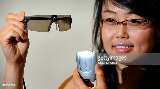 Researcher Mandy Li displays a prototype bionic eye designed to help patients suffering from degenerative vision loss caused by retinitis pigmentosa...