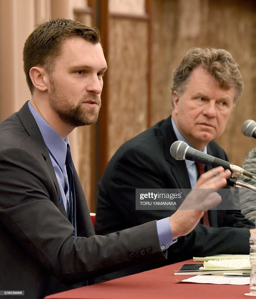 Researcher of LGBT rights program of the Human Rithts Watch (HRW) Kyle Knight (L) gestures as he answers questions beside Advocacy Derictor of HRW LGBT rights program Boris Dittrich (R) during a press conference in Tokyo on May 6, 2016. Human Rithts Watch reported that Japanese schools are filled with 'hateful' comments directed at gay and transgendered people, including from teachers, which aggravate bullying and drive some students into depression. / AFP / TORU