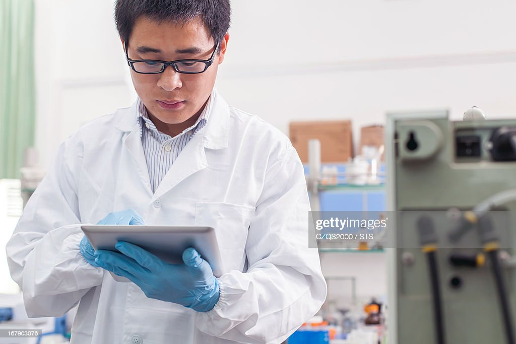researcher using digital tablet in lab : Stock Photo