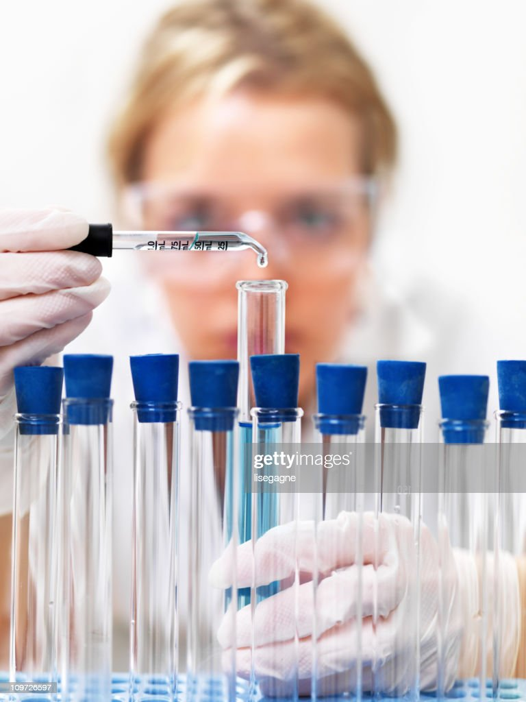 Researcher working with chemicals : Stock Photo