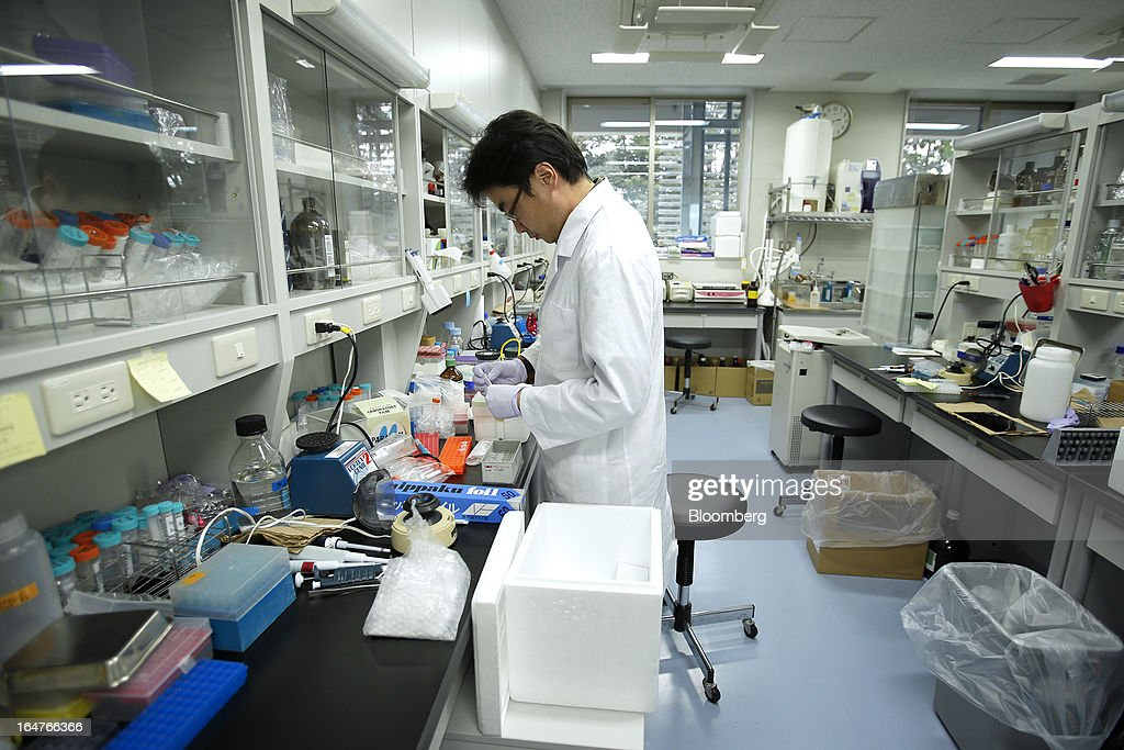 A researcher works in a laboratory at Yokohama City University's (YCU) Advanced Medical Research Center (AMRC) in Yokohama City, Kanagawa Prefecture, Japan, on Monday, March 18, 2013. Japan aims to be a nation with the most advanced medical technologies and healthcare services in the world and to develop the medical industries for the revitalization of the country's economy. Photographer: Kiyoshi Ota/Bloomberg via Getty Images