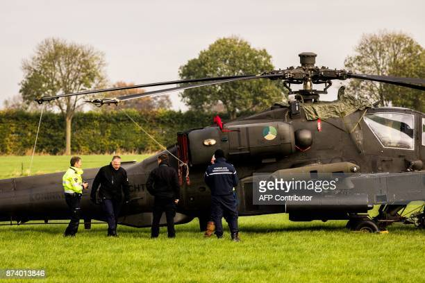 Researchers and Dutch police gather at the area where an Apache helicopter of Dutch Defense flown against a high voltage cable in Zoelmond on...