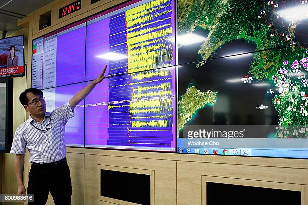 Researchers check the seismic waves that were measured in South Korea at the Earthquake and Volcano Monitoring Division on September 9 2016 in Seoul...