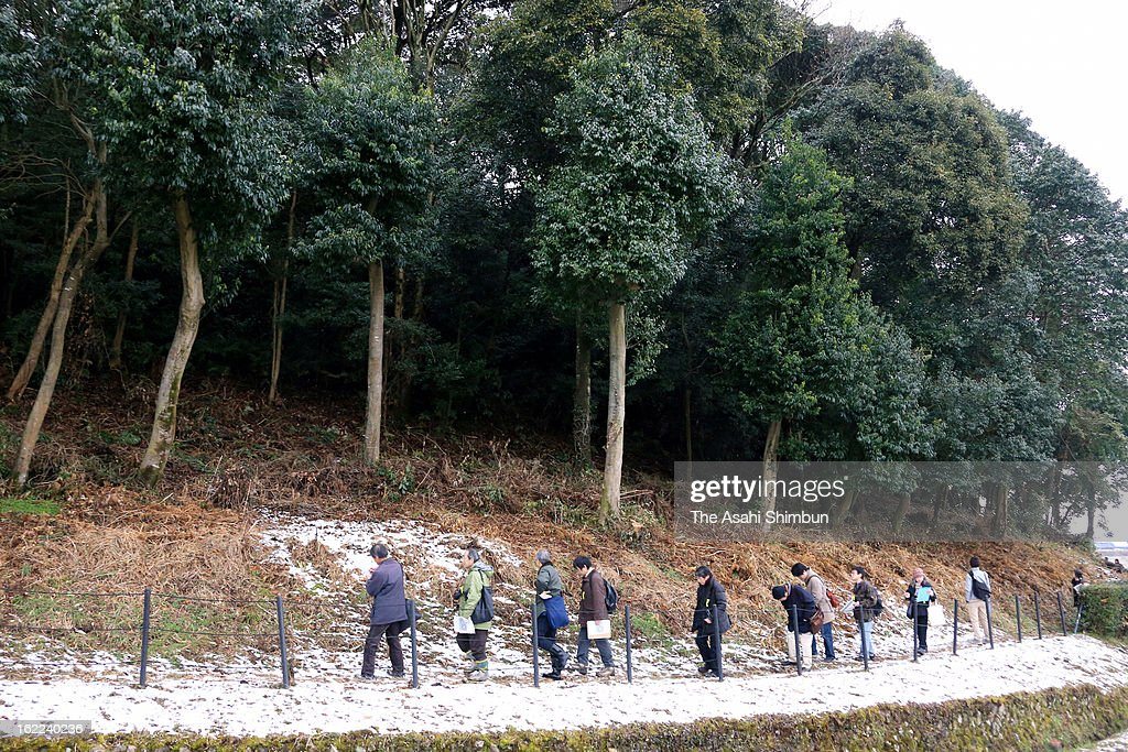 Researchers investigate the Hashihaka Ancient Tomb on February 20, 2013 in Sakurai, Nara, Japan. The tomb, some researchers believe Queen Himiko's, is open for the investigation for the first time due to the tomb is under the Imperial Household Agency.
