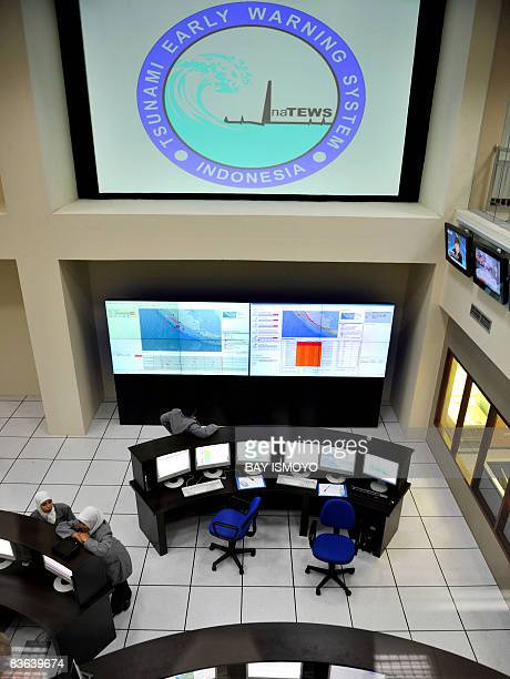 Researchers monitor their screens to get the tsunami early warning at the meteorology and geophysics bureau in Jakarta on November 11 2008 as they...