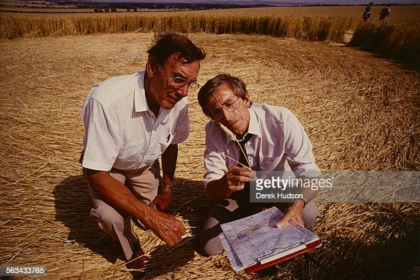 Researchers Pat Delgado and Colin Andrews examine a crop circle in a field near Salisbury UK 23rd July 1990