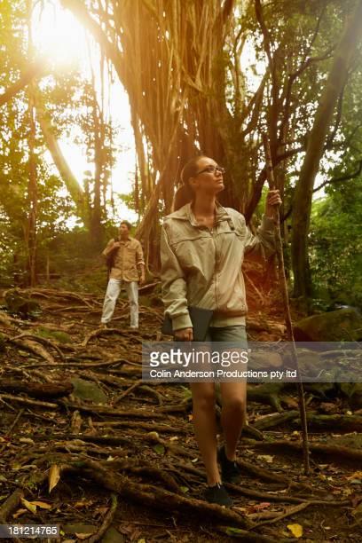 Researchers walking in jungle