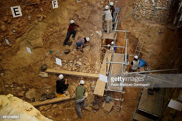 Researchers work on the archeological site 'Pit of Elephant' in Atapuerca Mountains on July 16 2015 near Ibeas de Juarros in Burgos province Spain...