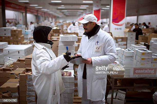 A reseller negociates with a seller at the poultry department of the international food market of Rungis on December 11 2012 AFP PHOTO MARTIN BUREAU