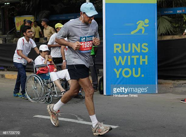 Reserve Bank of India Governer Raghuram Rajan runs during the 12th edition of the Standard Chartered Mumbai Marathon 2015 on January 18 2015 in...