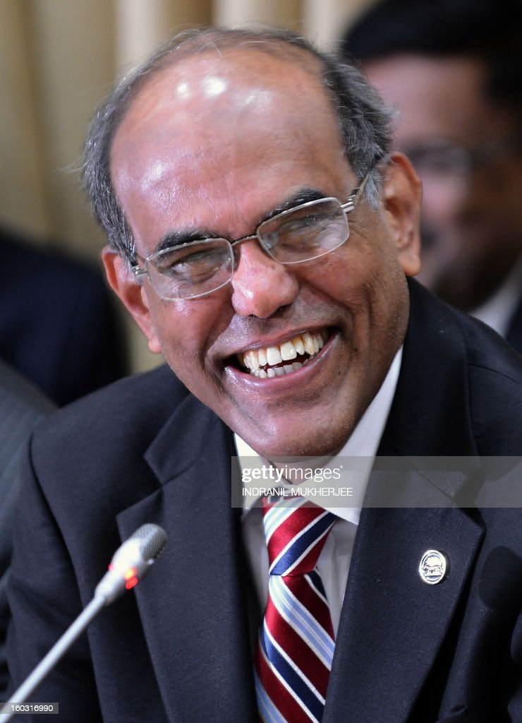 Reserve Bank of India (RBI) governor Duvvuri Subbarao smiles during a press conference in Mumbai on January 27, 2013. India's central bank-RBI, cut its main interest rates by 25 basis points, in its first reduction for nine months as it seeks to kick start the slowing economy. AFP PHOTO/ INDRANIL MUKHERJEE